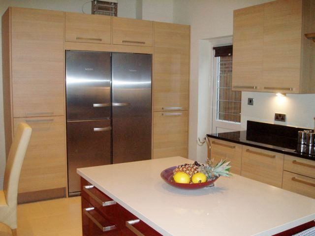 Designer fitted kitchen in Oak & red gloss lacquer